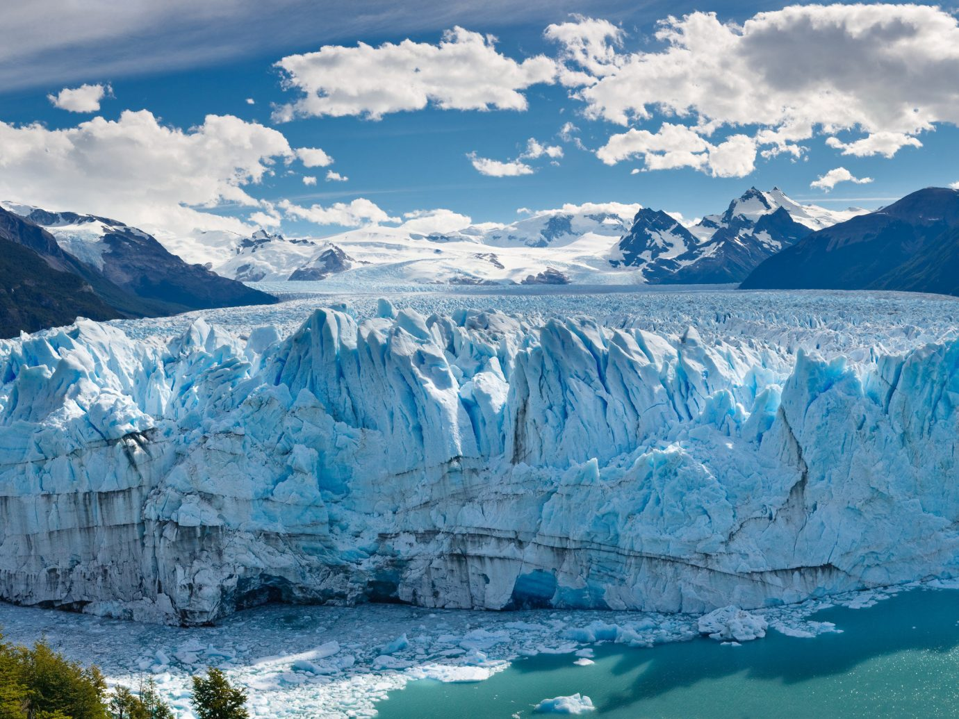 Jetsetter Guides Outdoors + Adventure Packing Tips Travel Tips Trip Ideas mountain sky Nature outdoor ice glacier glacial lake wilderness glacial landform mount scenery ice cap polar ice cap cirque water resources canyon fjord iceberg moraine mountain range crater lake background terrain national park arctic sea ice cliff Lake melting massif watercourse arctic ocean water computer wallpaper overlooking distance