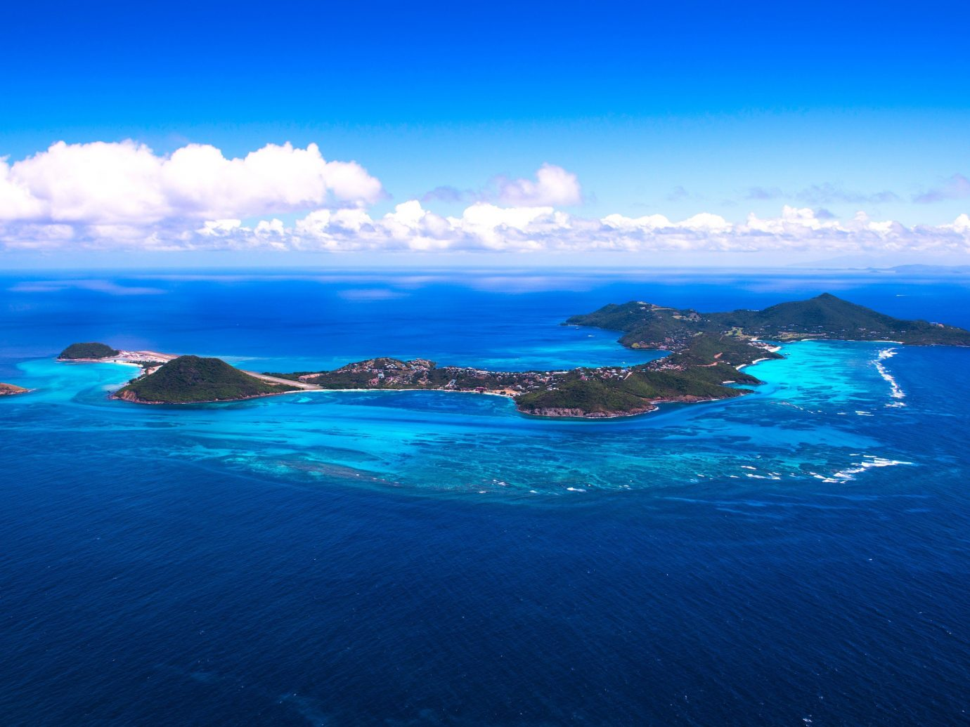 caribbean Secret Getaways Trip Ideas sky water outdoor blue Nature geographical feature landform Sea Coast Ocean horizon archipelago islet clouds reef cape Island bay arctic ocean terrain swimming