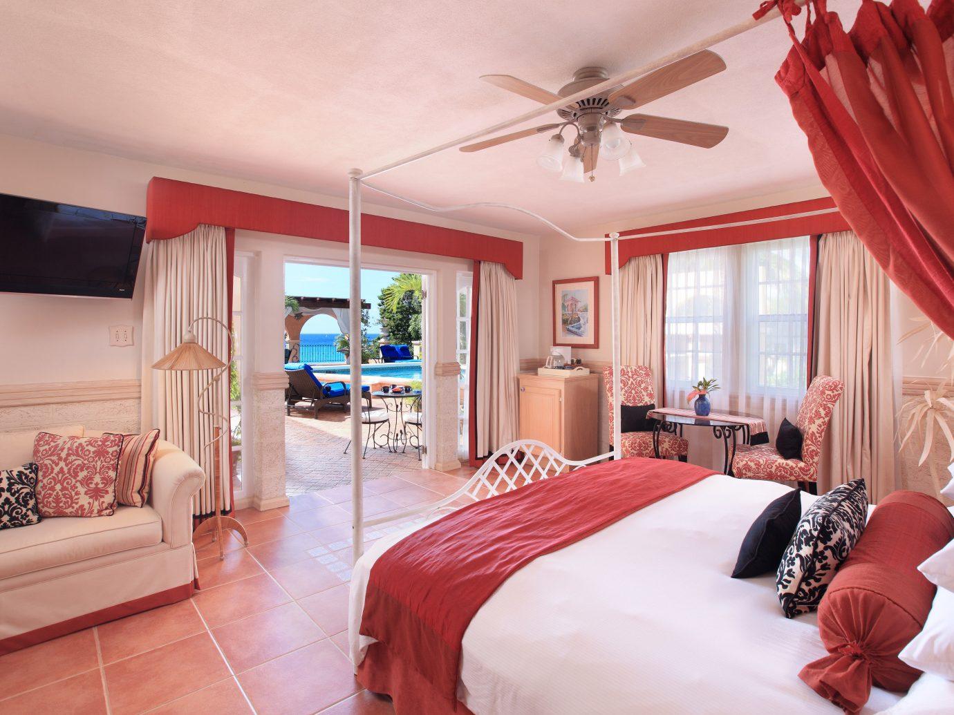 Hotels indoor bed red room sofa floor wall window Bedroom property hotel estate Suite decorated real estate home furniture interior design cottage living room pillow Villa