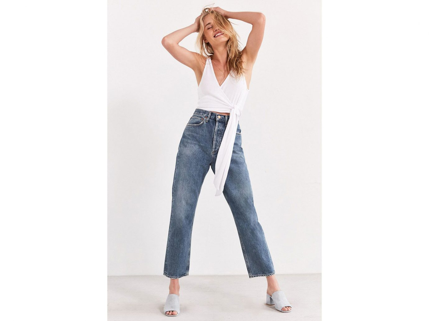 Travel Shop Travel Trends clothing woman person jeans denim fashion model waist lady shoulder trousers trouser trunk joint abdomen posing one piece garment neck supermodel beautiful pretty