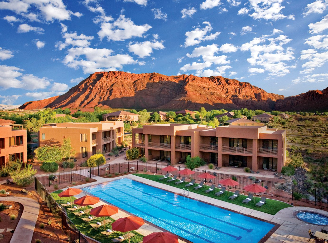 Health + Wellness Hotels Meditation Retreats Trip Ideas Yoga Retreats mountain sky outdoor property estate vacation canyon Resort tourism real estate Village swimming pool colorful