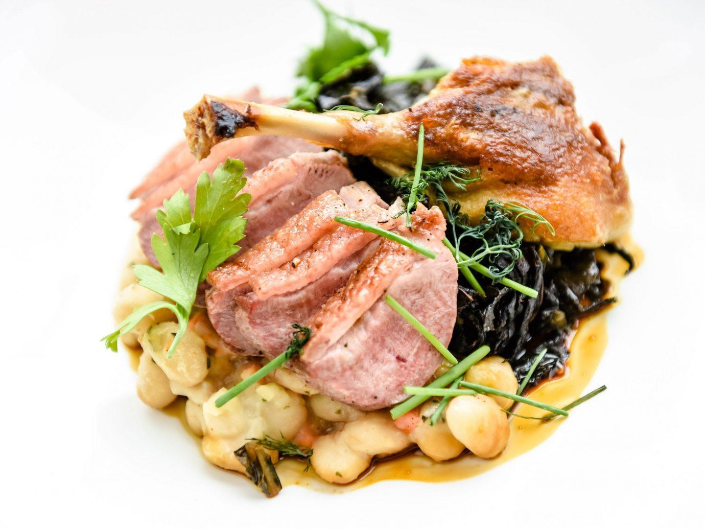 Food + Drink food dish plate meat cuisine produce vegetable steak veal pork chop meal pasta piece de resistance