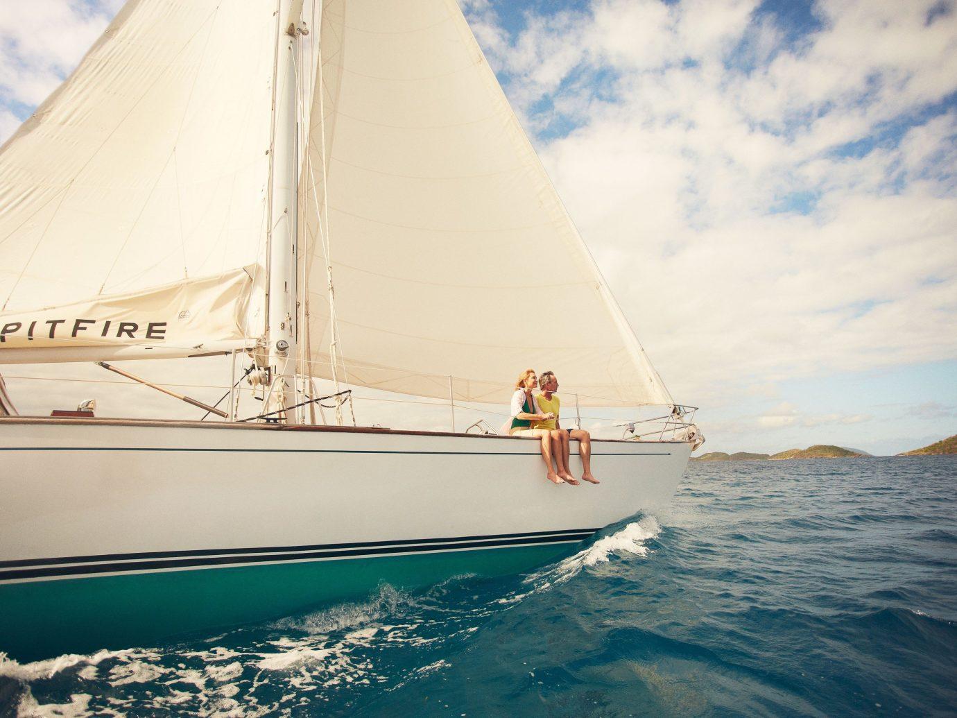 Couple sitting on a boat in St. John, US Virgin Islands