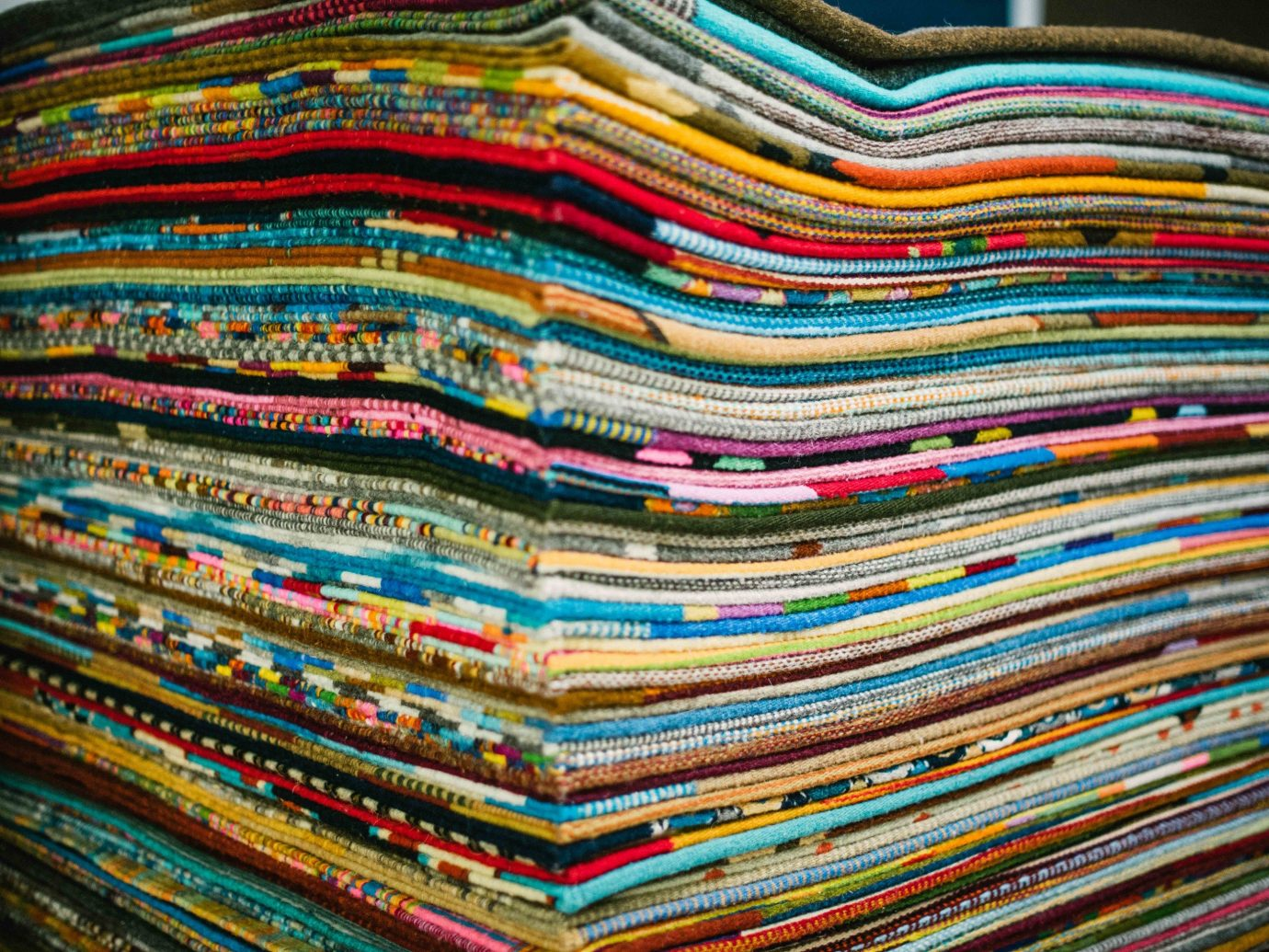 Arts + Culture Mexico Oaxaca Trip Ideas textile thread material colorful pattern stack colored