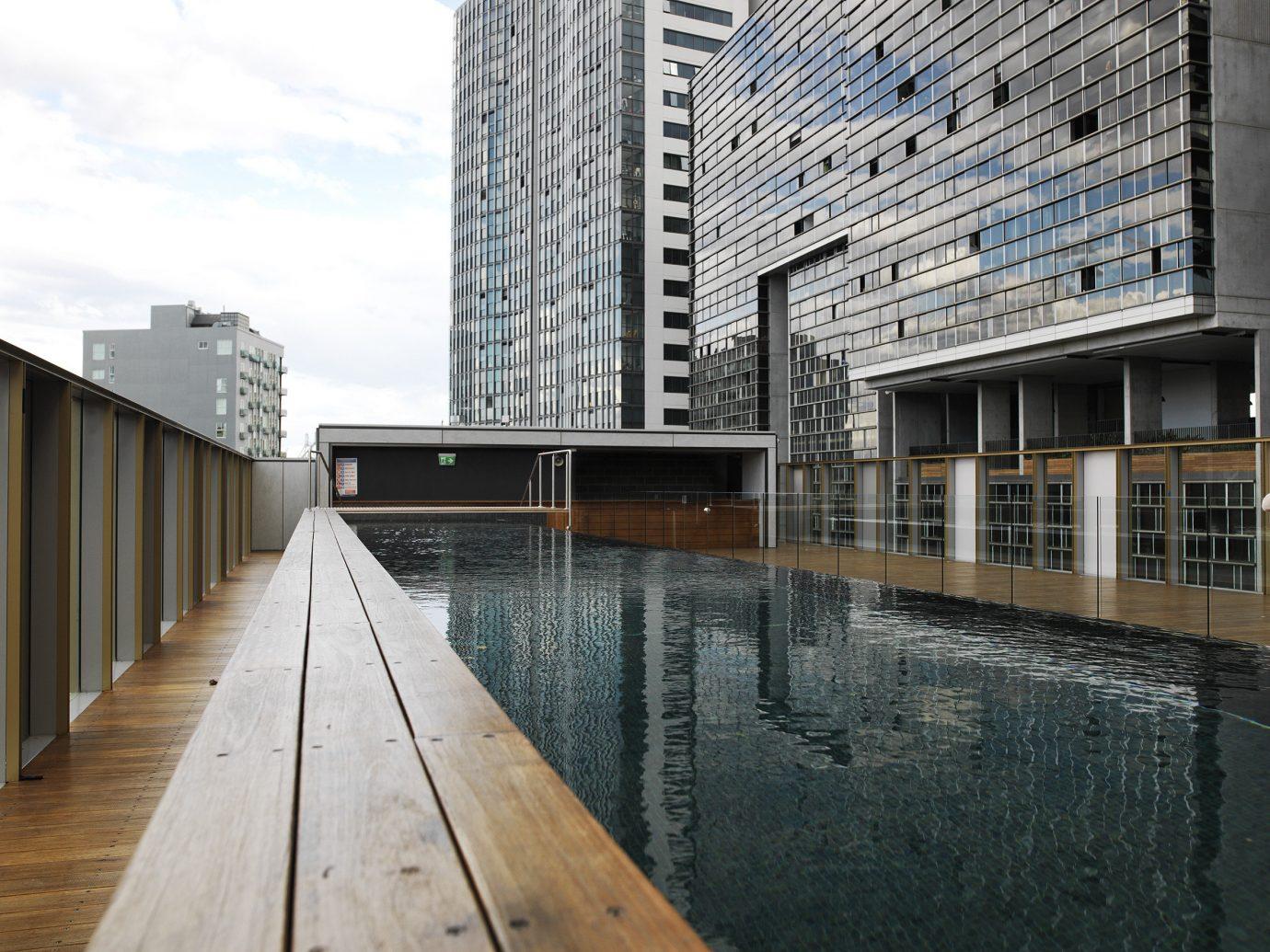Trip Ideas building outdoor property Architecture condominium wooden facade professional tower block estate headquarters stone concrete cement walkway