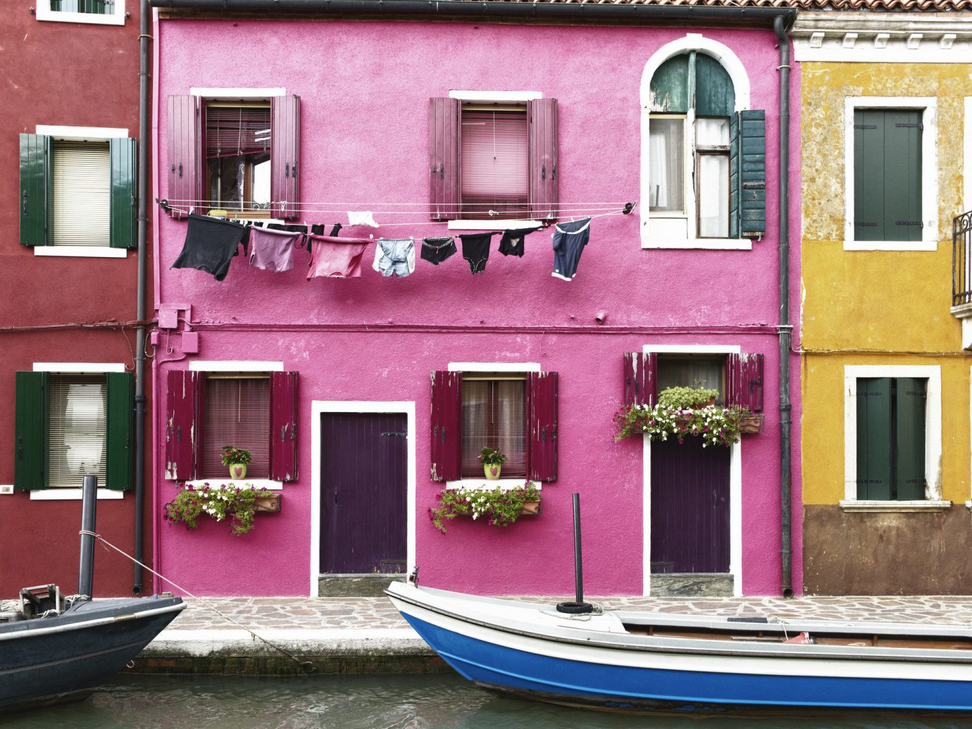 Offbeat outdoor color house pink home facade vehicle interior design Balcony old Boat colored