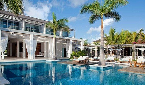 Hotels building tree outdoor Resort swimming pool property leisure condominium estate Villa Pool resort town caribbean mansion real estate palm area swimming