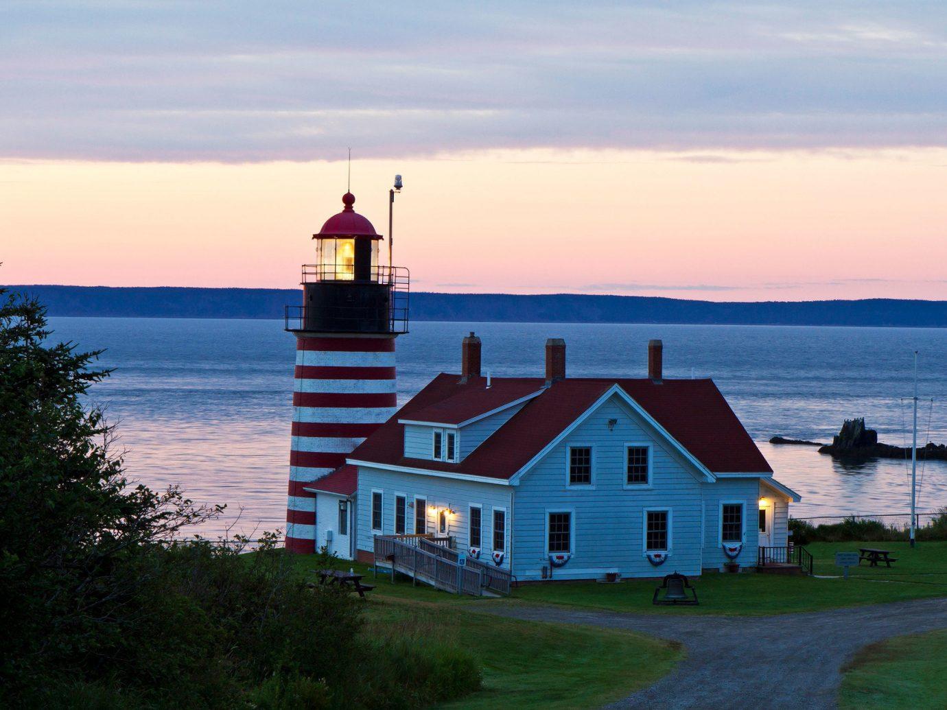 Trip Ideas sky outdoor water house tower lighthouse Sea Coast vacation Ocean Sunset dusk bay distance