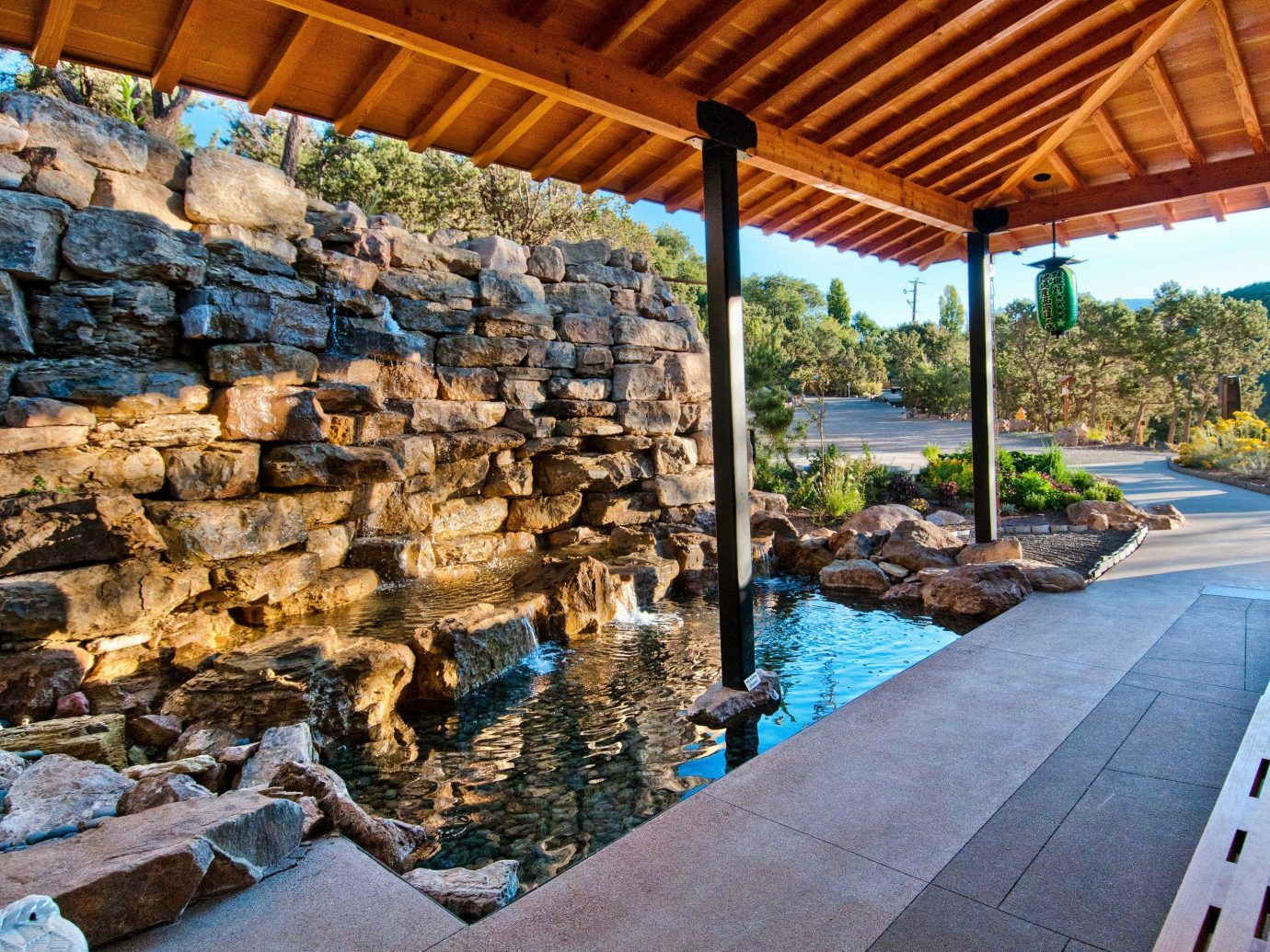 water landscape outdoor structure real estate backyard swimming pool landscaping Patio water feature rock