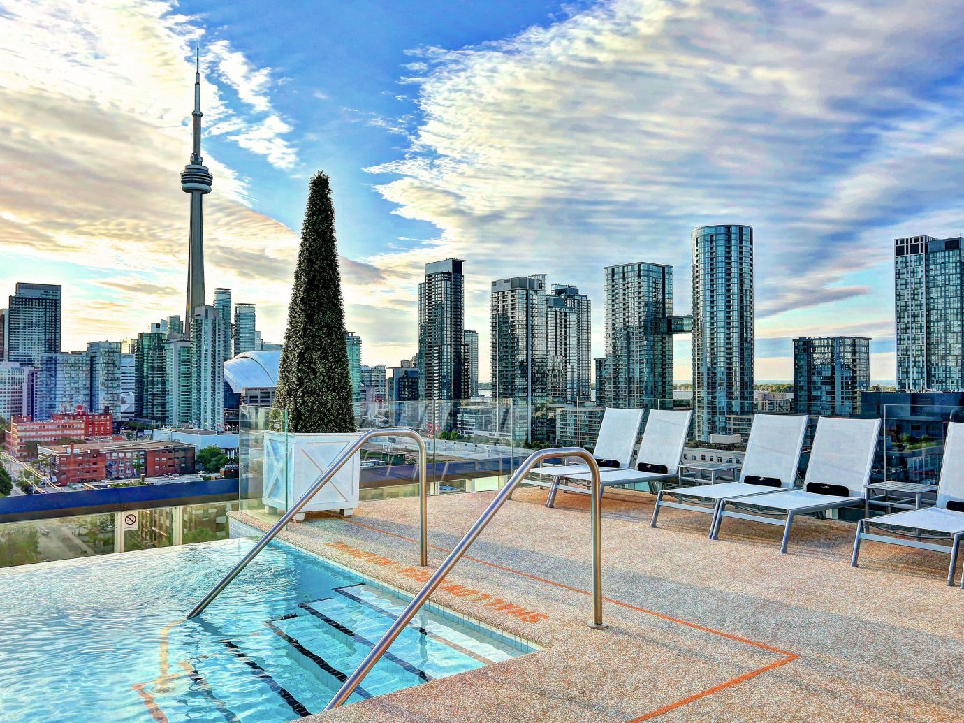 Canada Hotels Toronto sky outdoor condominium leisure property City skyline human settlement plaza skyscraper Downtown residential area cityscape tower block real estate estate overlooking day