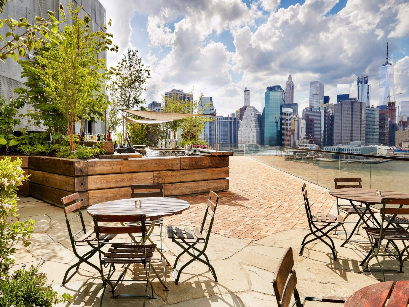 Food + Drink NYC property real estate tree outdoor structure City sky water roof plant Patio condominium