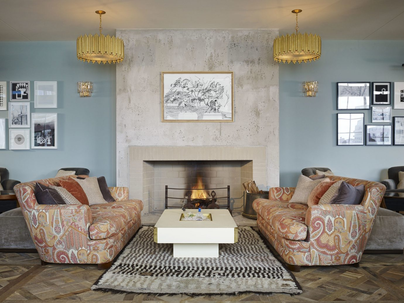 Boutique Hotels Chicago Hotels Trip Ideas indoor sofa Living wall floor room living room property home cottage estate house hardwood interior design real estate farmhouse Villa dining room Fireplace hearth apartment furniture area