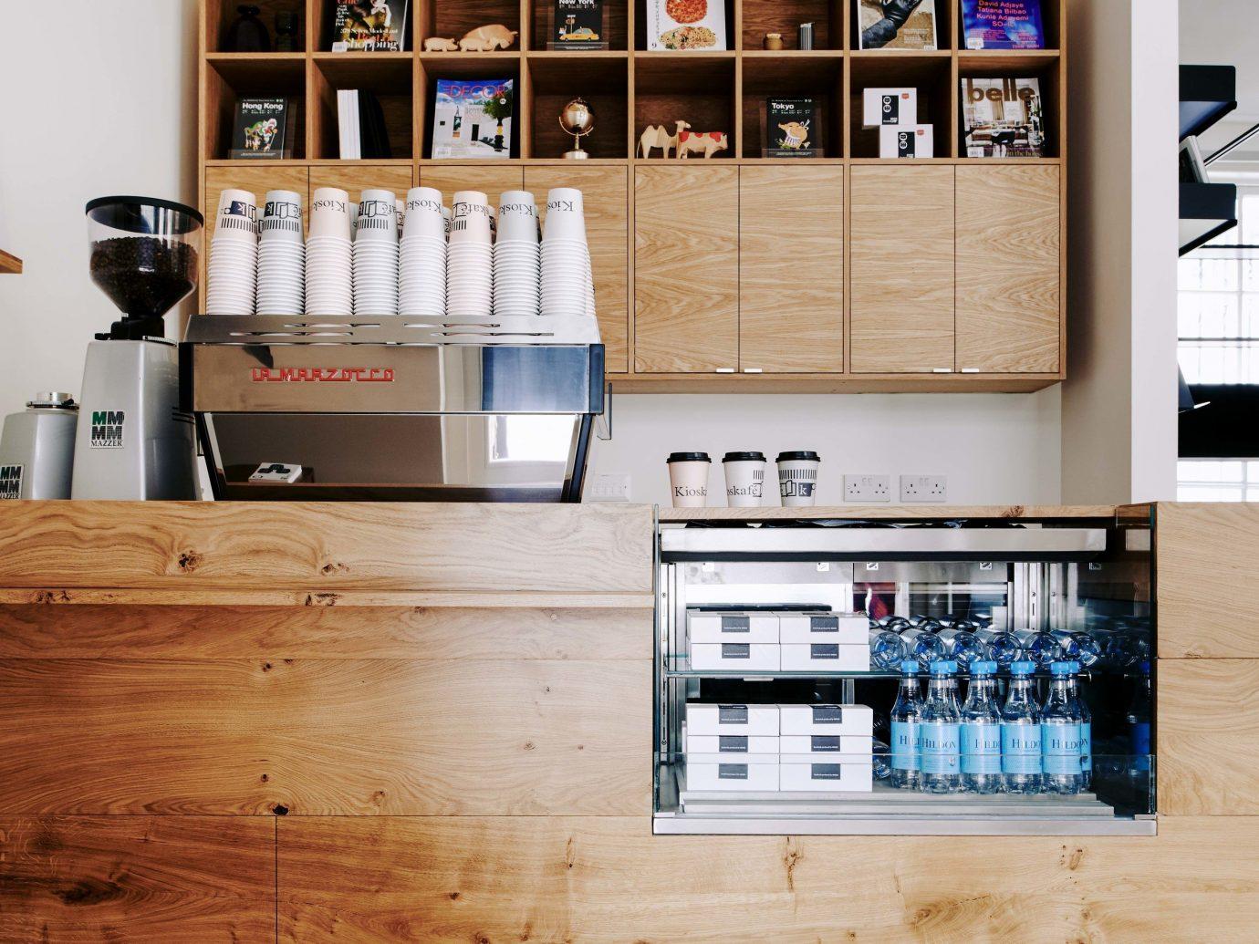indoor shelving furniture shelf interior design flooring floor bookcase cabinetry Kitchen hardwood coffee Kioskafé Monocle