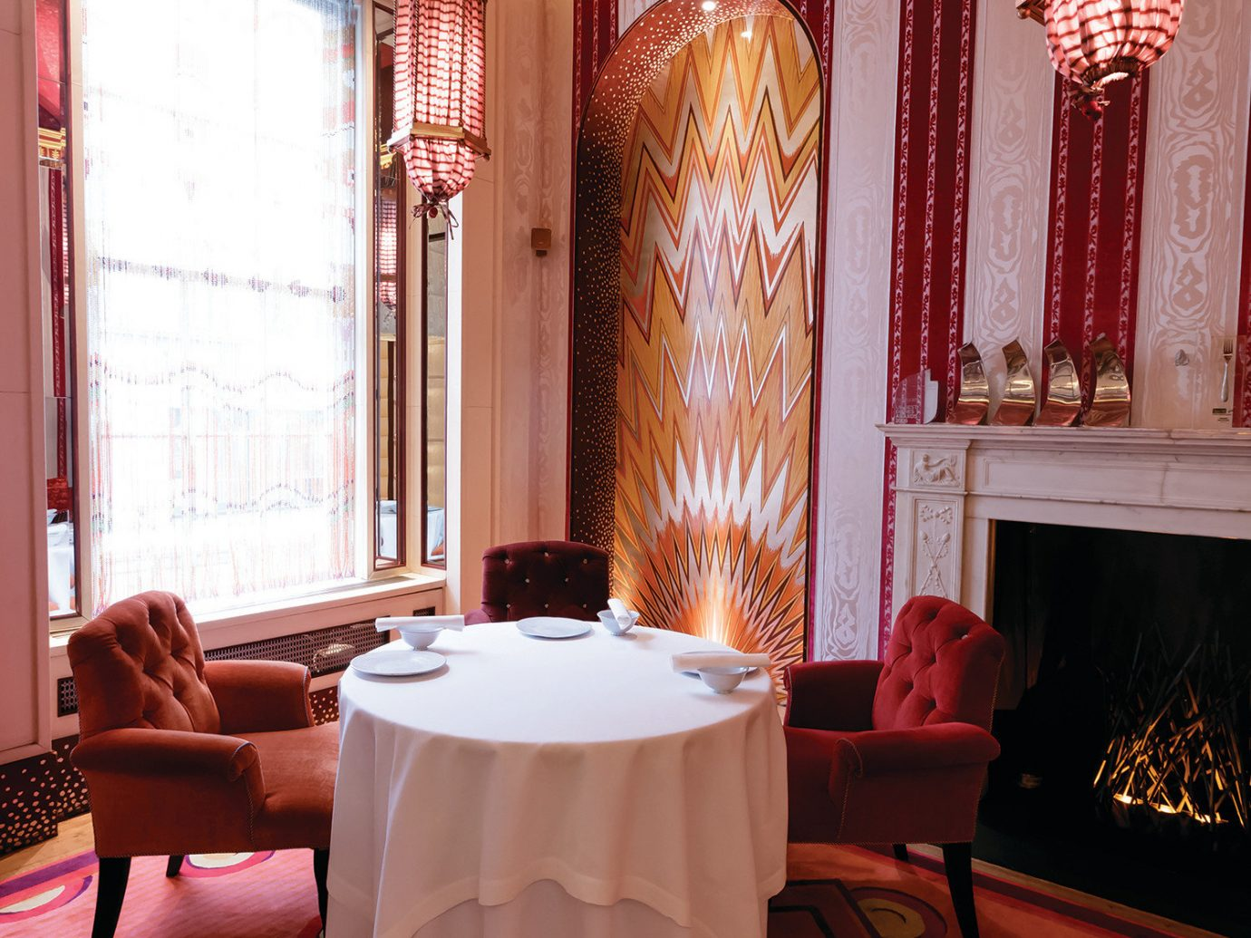 Sketch London private table next to fireplace
