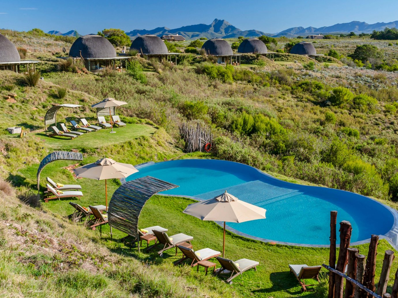 Gondwana Game Reserve; property leisure real estate rural area Resort tree estate landscape swimming pool plant tourism grass sky aerial photography bay land lot water Villa house Village