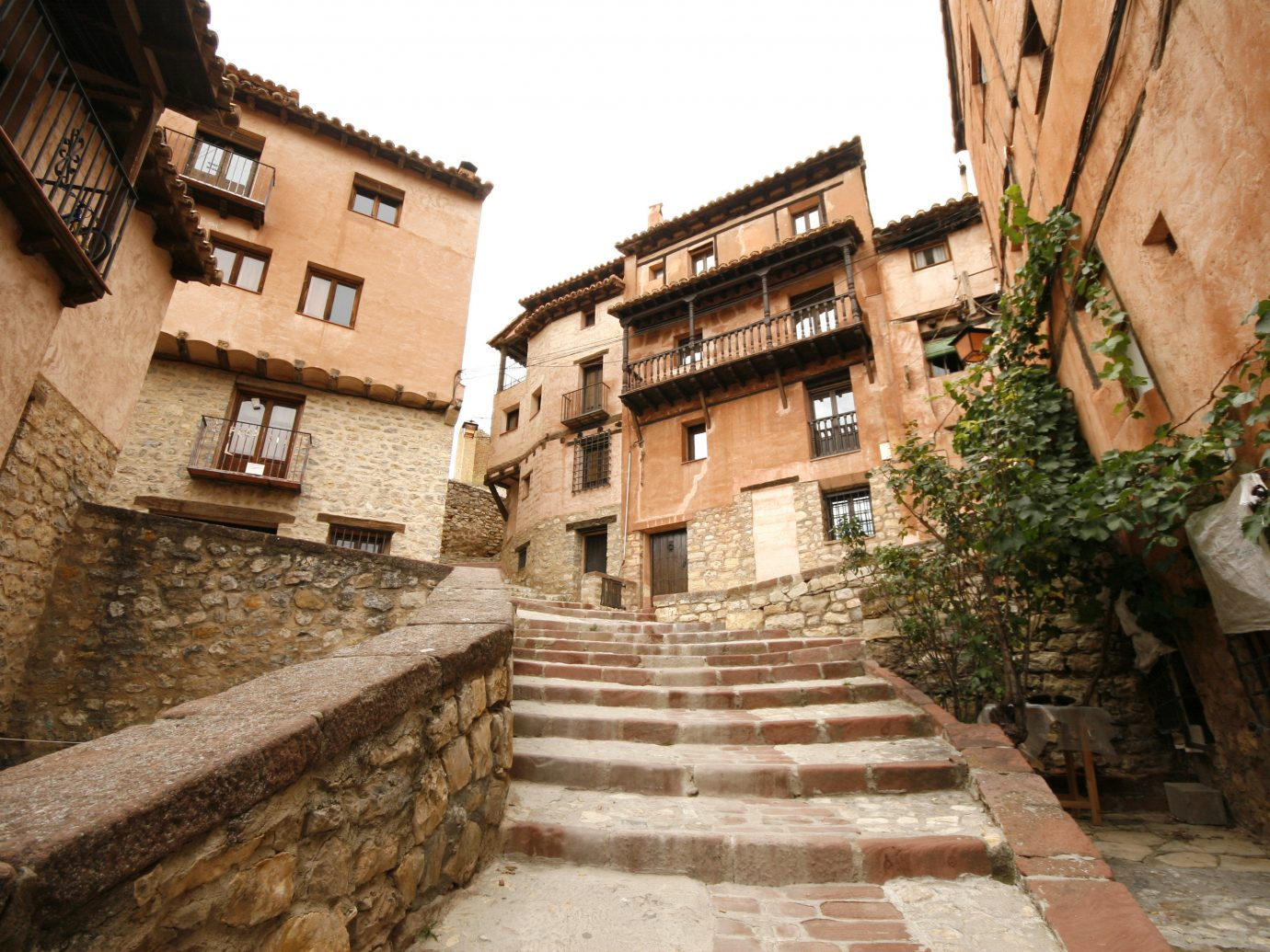 europe Spain Trip Ideas Town neighbourhood alley street historic site history Village City building facade window medieval architecture road