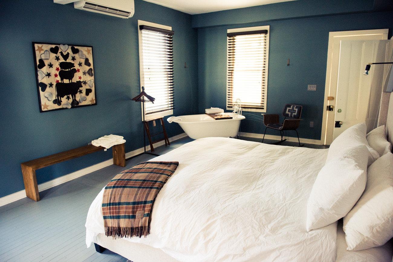 Romance Trip Ideas Weekend Getaways indoor bed wall room hotel property Bedroom living room interior design Suite home Design furniture pillow estate window covering cottage