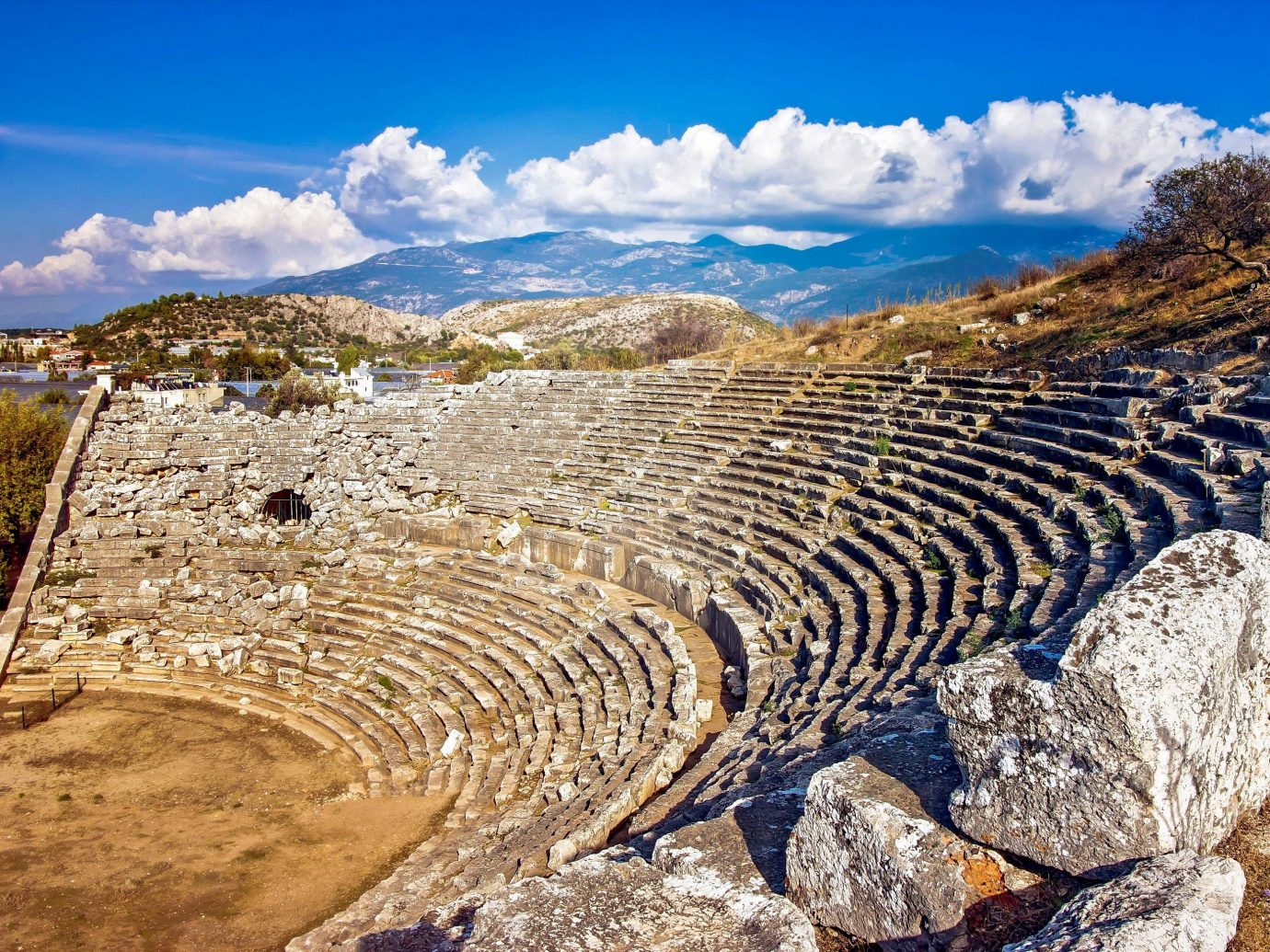 europe Outdoors + Adventure Trip Ideas amphitheatre sky historic site ancient history archaeological site Ruins rock geology landscape field tourism cloud unesco world heritage site elevation Terrace mountain formation