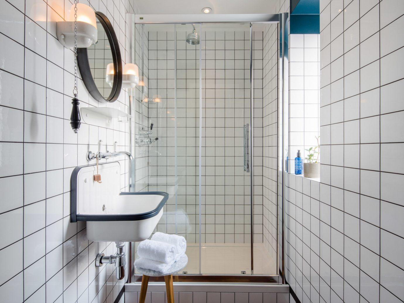 bathroom room tile wall interior design plumbing fixture floor flooring window toilet daylighting