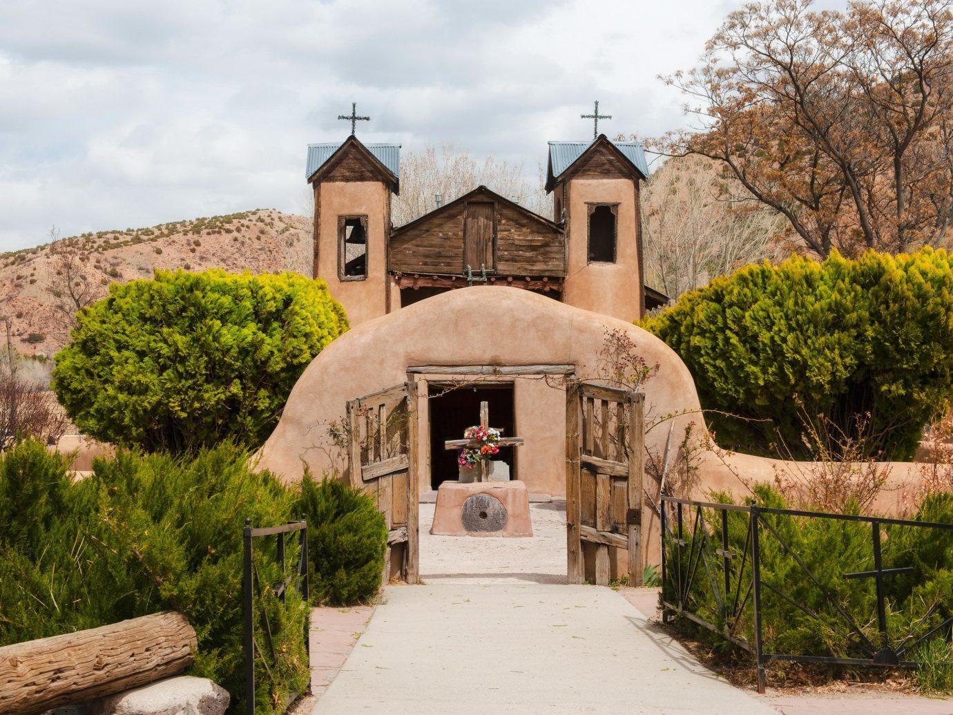historic site estate chapel medieval architecture building tree cottage hacienda spanish missions in california place of worship Village tourism Villa
