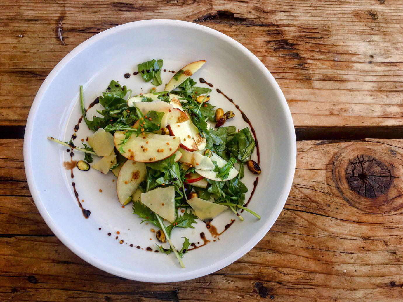 Girls Getaways Trip Ideas Weekend Getaways plate food table dish salad vegetable vegetarian food wooden leaf vegetable side dish spinach salad recipe cuisine meal tomato wood meat