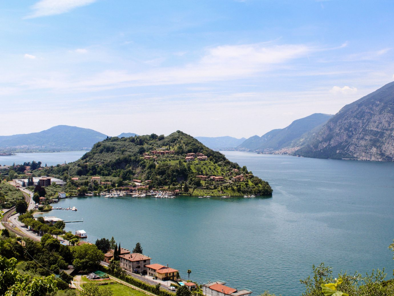 europe Italy Off-the-beaten Path Trip Ideas sky Coast Sea Lake promontory water mount scenery highland mountain reservoir tree bay fjord loch River hill hill station cloud City tourism landscape mountain range cape horizon Village bank plant inlet fell