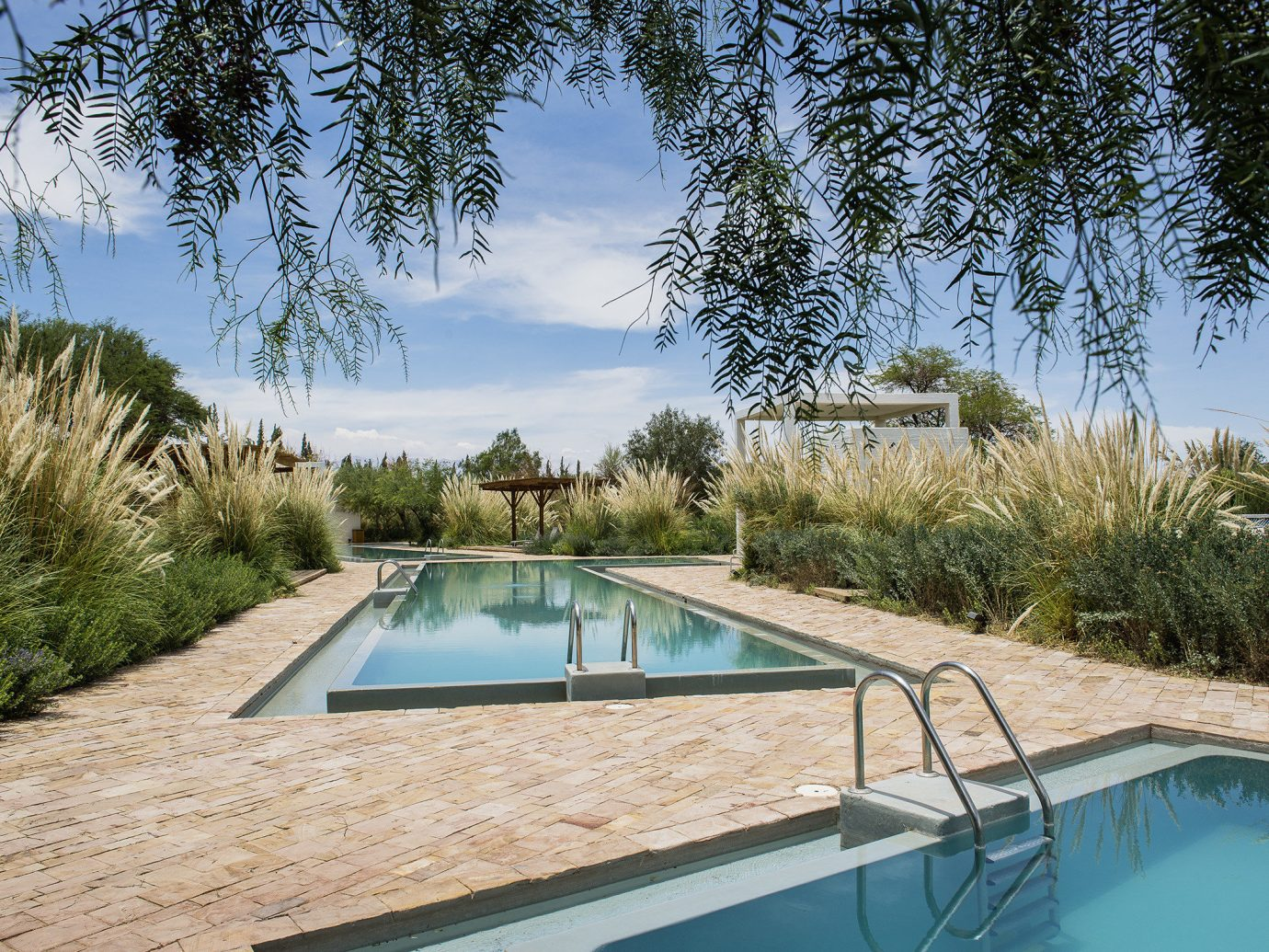 Trip Ideas swimming pool property estate real estate water leisure tree Villa Resort plant house reflecting pool outdoor structure sky arecales palm tree landscape amenity vacation landscaping