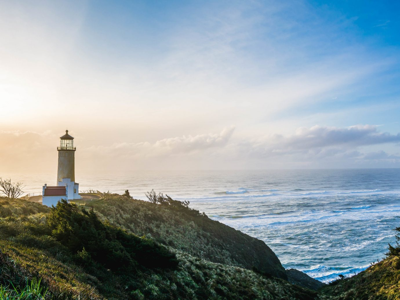America Beach Trip Ideas West Coast sky Sea lighthouse Coast tower promontory shore headland Ocean cloud horizon morning terrain cape tree beacon daytime sunlight calm coastal and oceanic landforms cliff tourism landscape evening cove bay