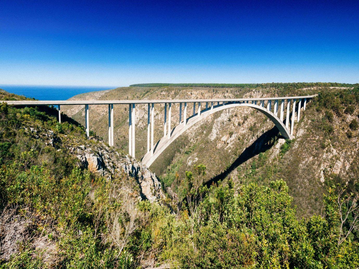 Bloukrans Bungy bridge viaduct arch bridge sky aqueduct concrete bridge escarpment reservoir fixed link devil's bridge landscape formation tree beam bridge national park