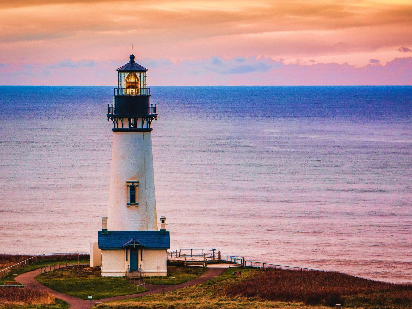 America Beach Trip Ideas West Coast lighthouse tower Sea sky beacon promontory Coast horizon shore Ocean cloud daytime evening headland dusk Sunset calm