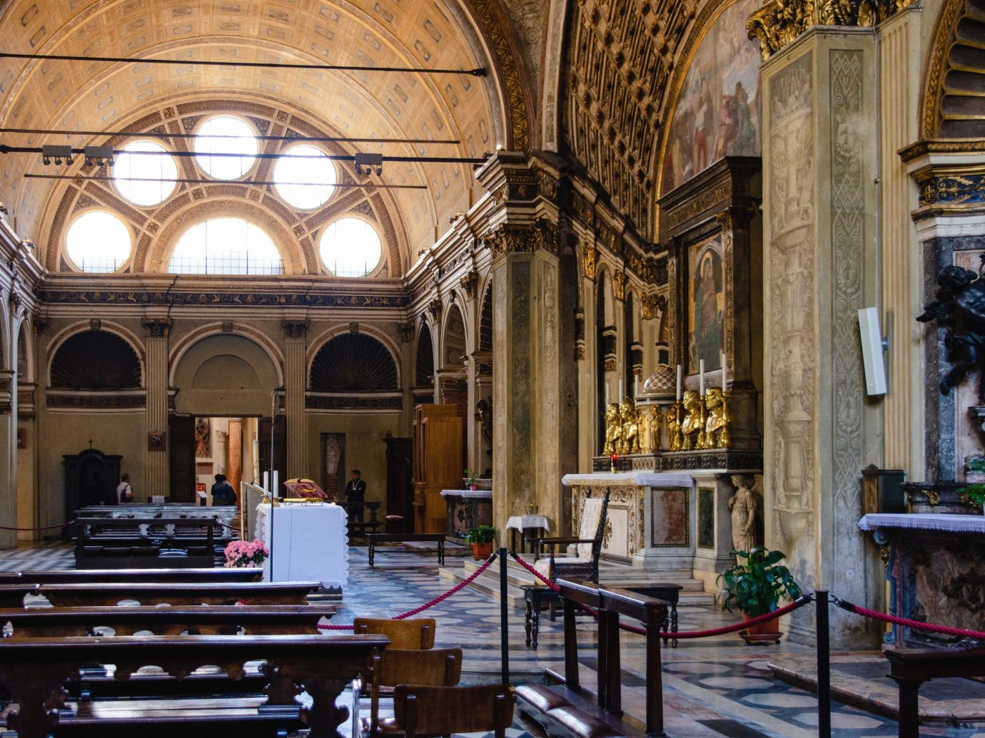 Arts + Culture Italy Milan indoor place of worship chapel building Church interior design cathedral basilica window abbey religious institute worship byzantine architecture arcade medieval architecture Lobby altar