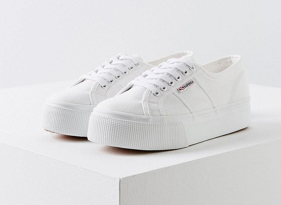 Packing Tips Style + Design Travel Shop footwear white sportswear shoe sneakers walking shoe product product design tennis shoe brand outdoor shoe font beige cross training shoe