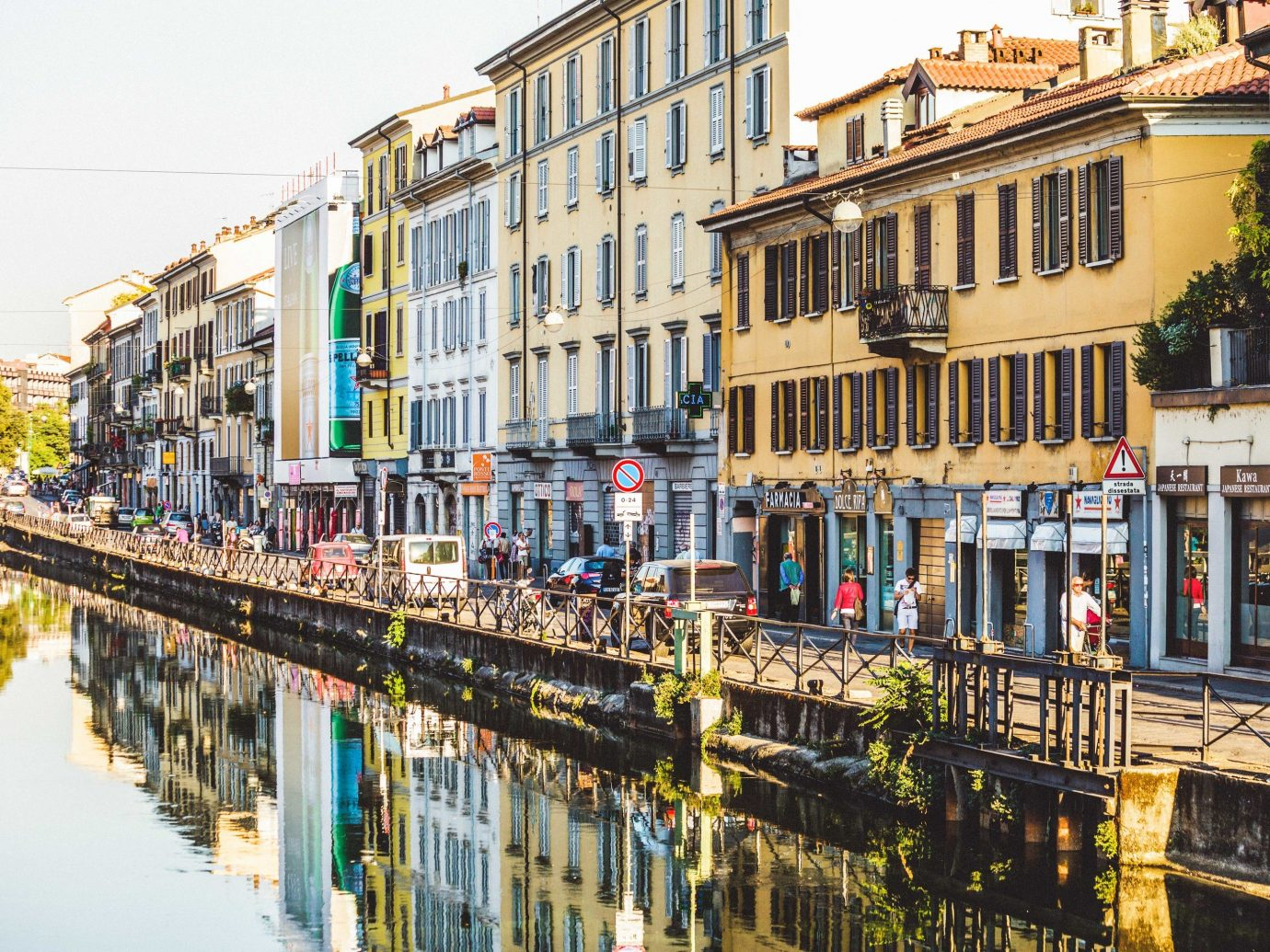 Arts + Culture Italy Milan waterway water Town neighbourhood Canal City reflection residential area street house building facade mixed use window sky apartment channel