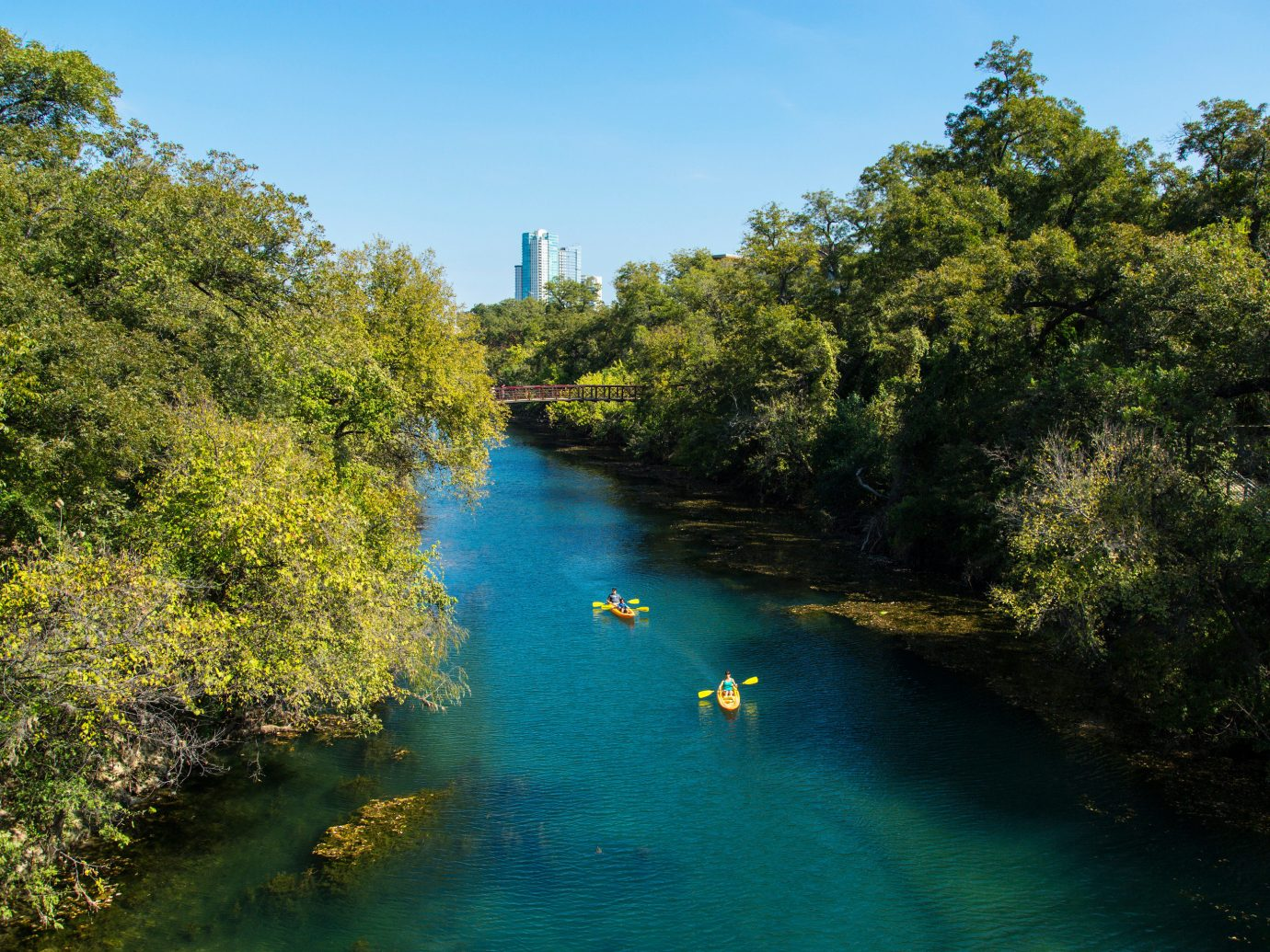 Austin Girls Getaways Texas Trip Ideas Weekend Getaways tree outdoor water sky Nature River landform geographical feature body of water waterway reflection reservoir Lake autumn Canal plant surrounded Forest wooded