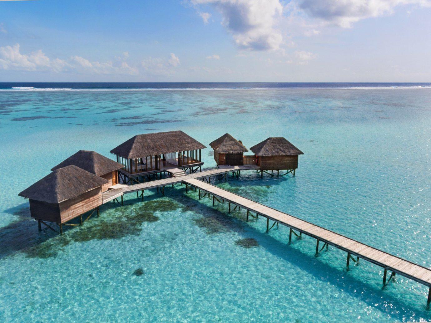 asia Beach Hotels Islands Maldives News Sea coastal and oceanic landforms Ocean Island Lagoon vacation swimming pool caribbean tropics islet sky Resort Coast tourism bay