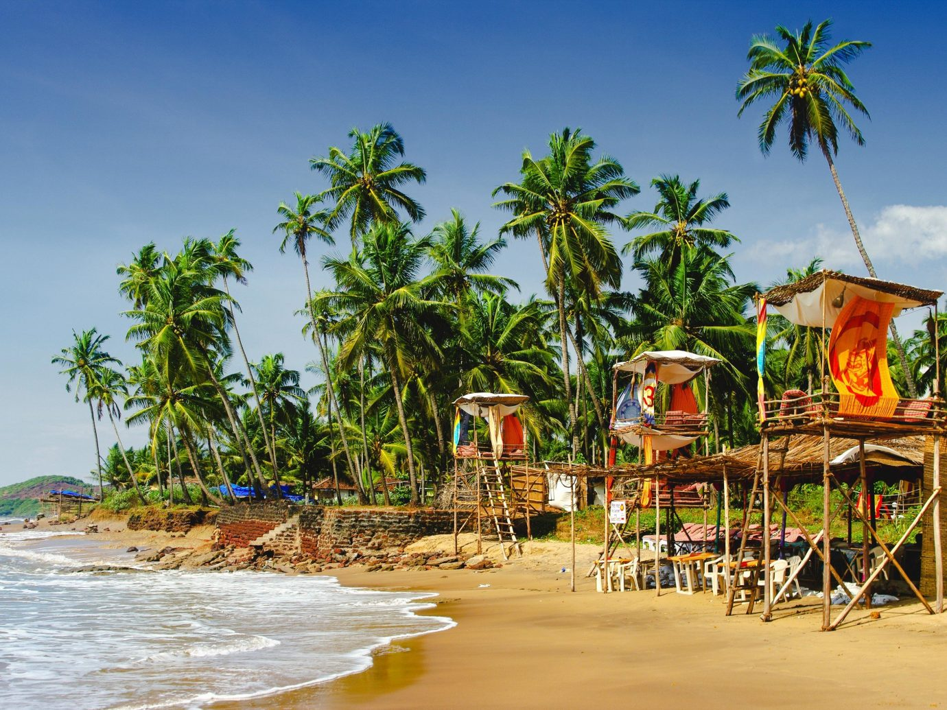 India body of water Beach palm tree arecales tropics tourism Resort tree sky vacation caribbean shore Sea leisure water Coast tourist attraction coastal and oceanic landforms Ocean