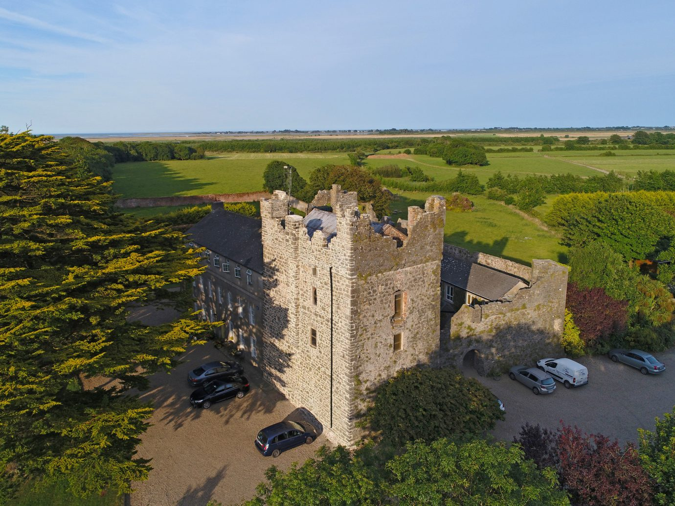europe Hotels Ireland sky tree aerial photography castle estate Village château plant rural area stately home national trust for places of historic interest or natural beauty building fortification landscape bird's eye view field grass historic site