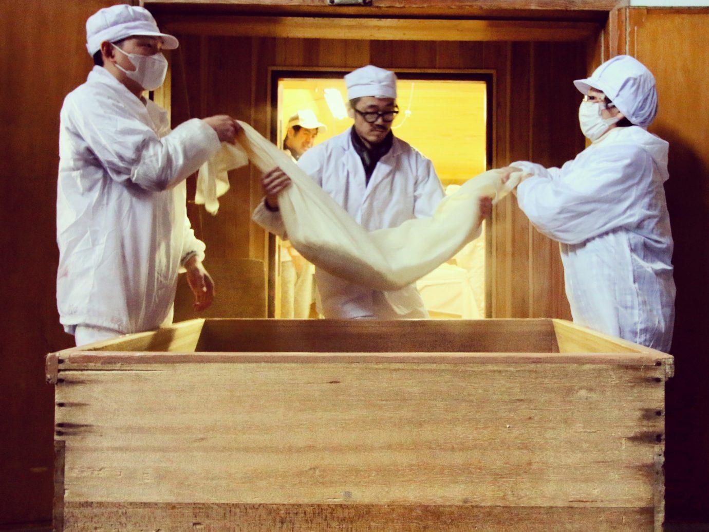 people making sake in japan