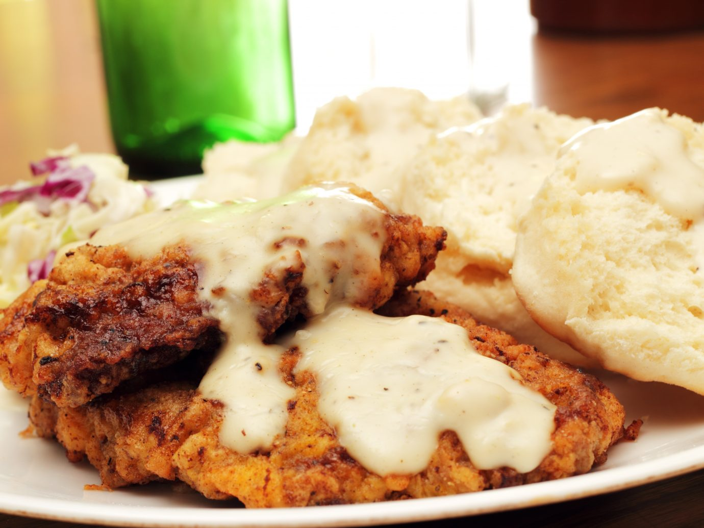 Chicken fried steak with biscuits and country gravy