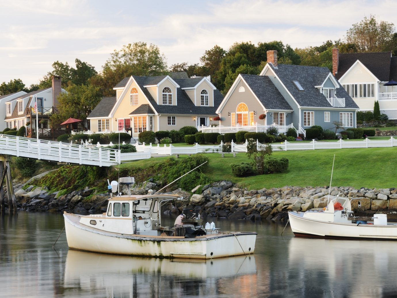 """Fishing boats with houses in background at sunrise, blurred water by long exposure, square picture (Perkins Cove, Ogunquit, Maine USA). Best of Maine and New England in lightbox below..."""
