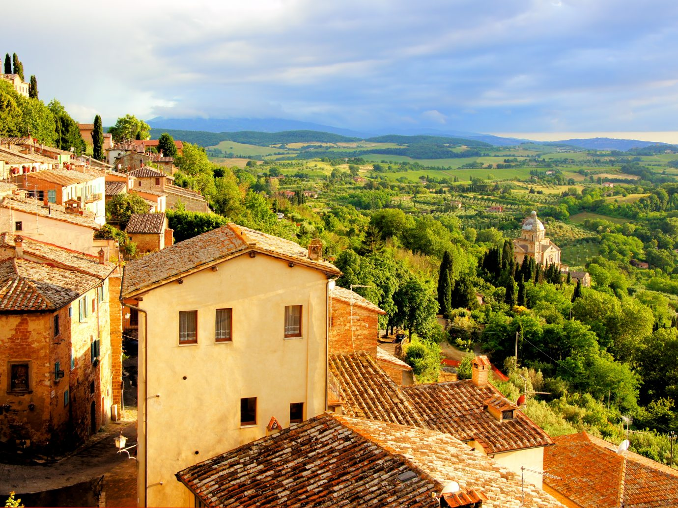 View over the Tuscan countryside and the town of Montepulciano at sunset, Italy