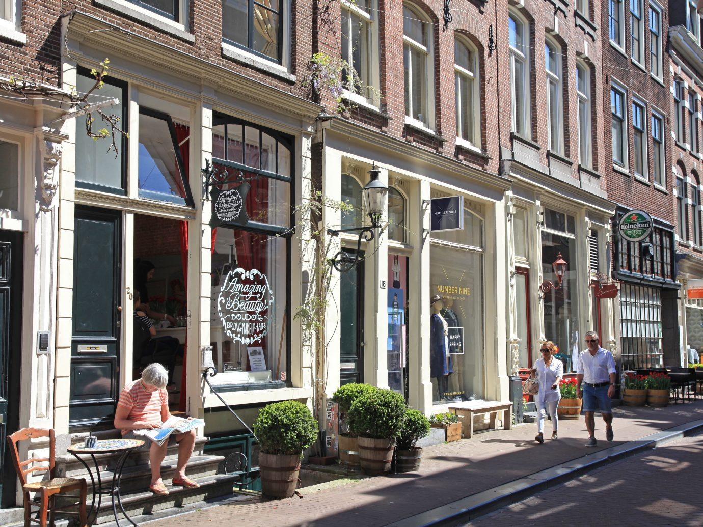 "Amsterdam, Netherlands - May 8, 2016: Typical street in ""??The Nine Streets""- special neighbourhood is full with vintage and designer shopping, speciality stores and cosy cafes, Amsterdam. Amsterdam is a capital and the largest city of Netherlands."
