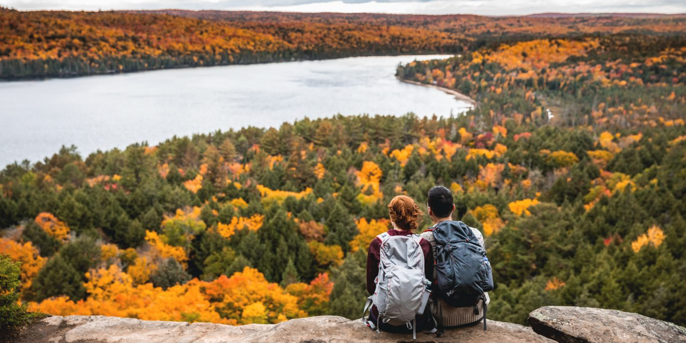 Young couple hiking in mountain and relaxing looking at view