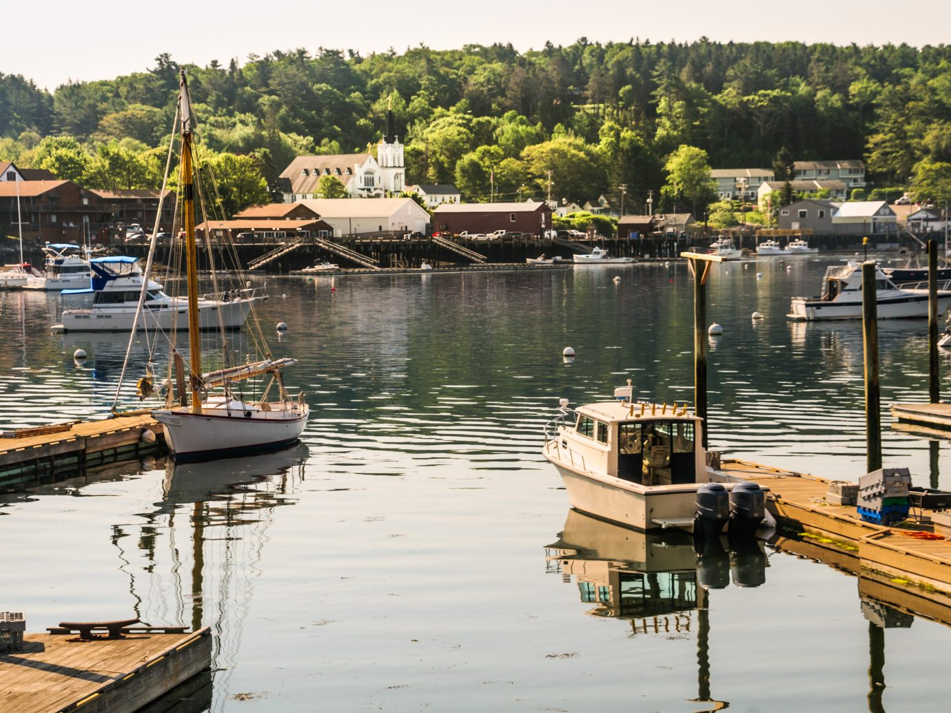 Morning light illuminates the boats in the waters of Boothbay Harbor, Maine in mid June.