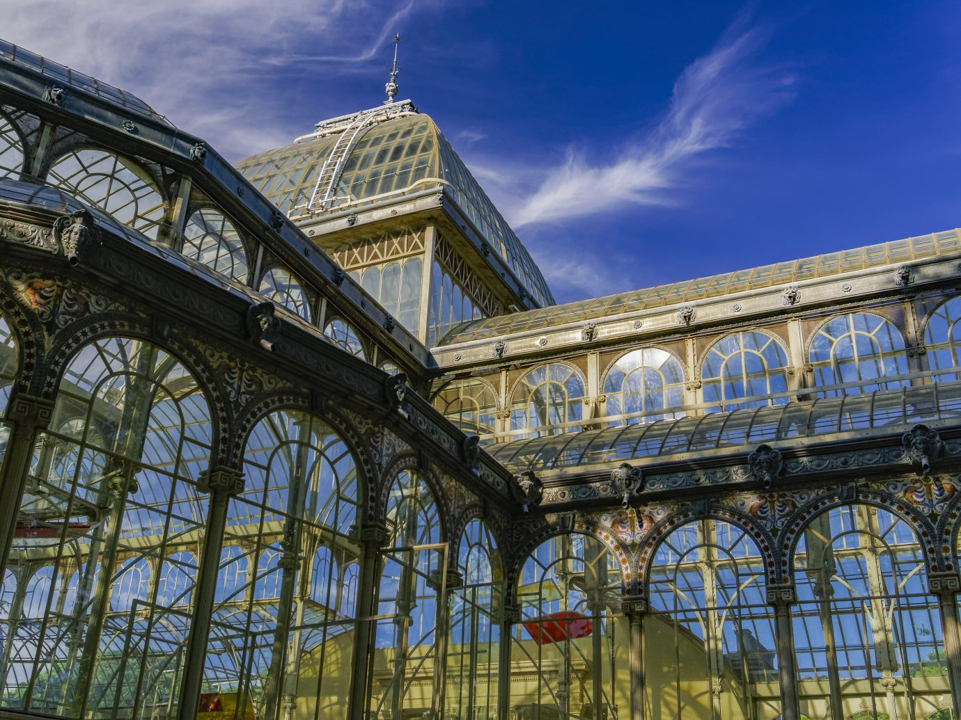 Day view of 1887 glass and metal structure of crystal palace at Park Retiro.