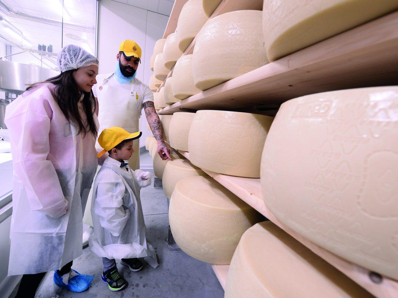 wheels of parmesan cheese at Eataly World