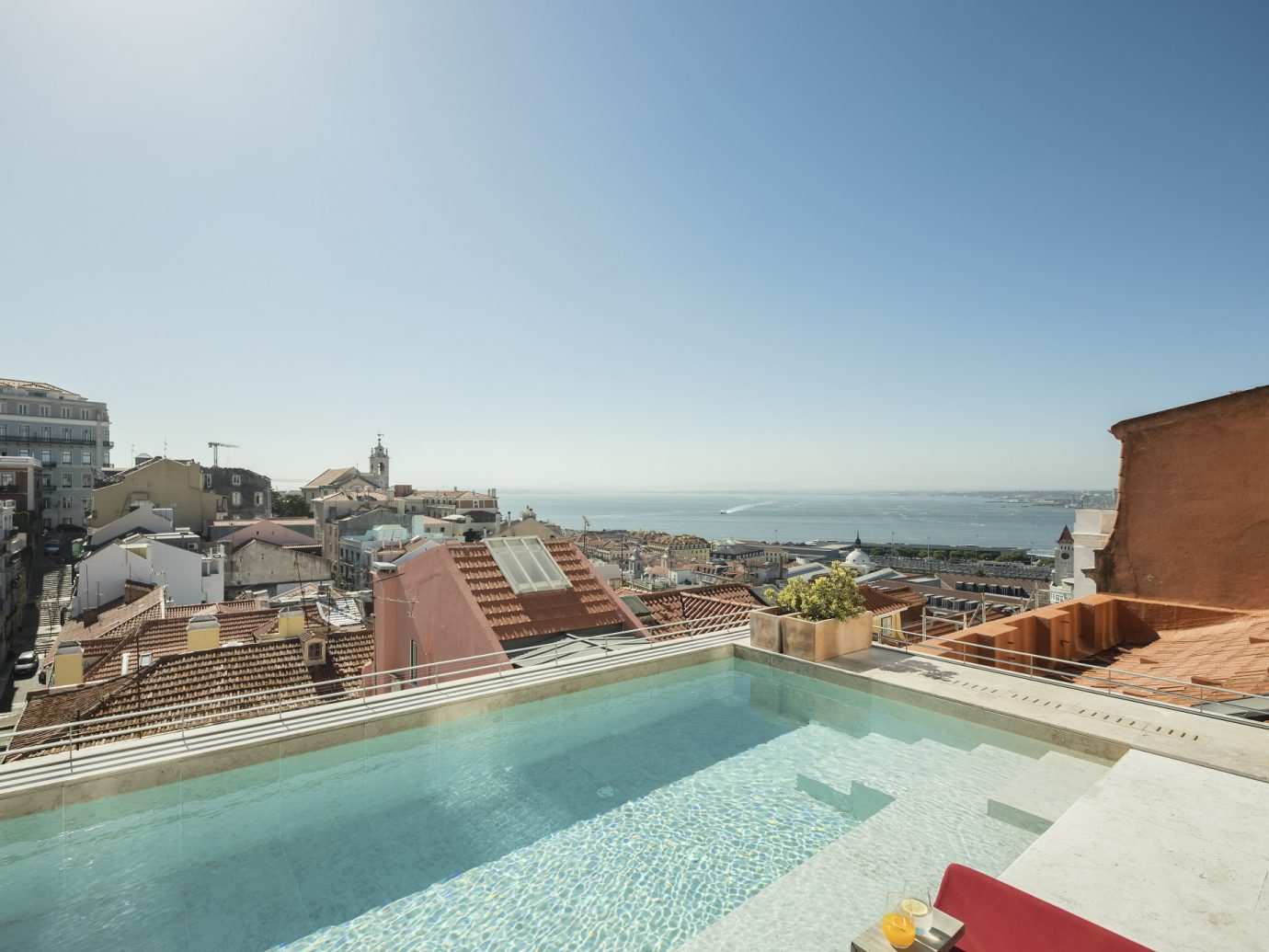 Rooftop swimming pool looking over Lisbon at Verride Palácio Santa Catarina