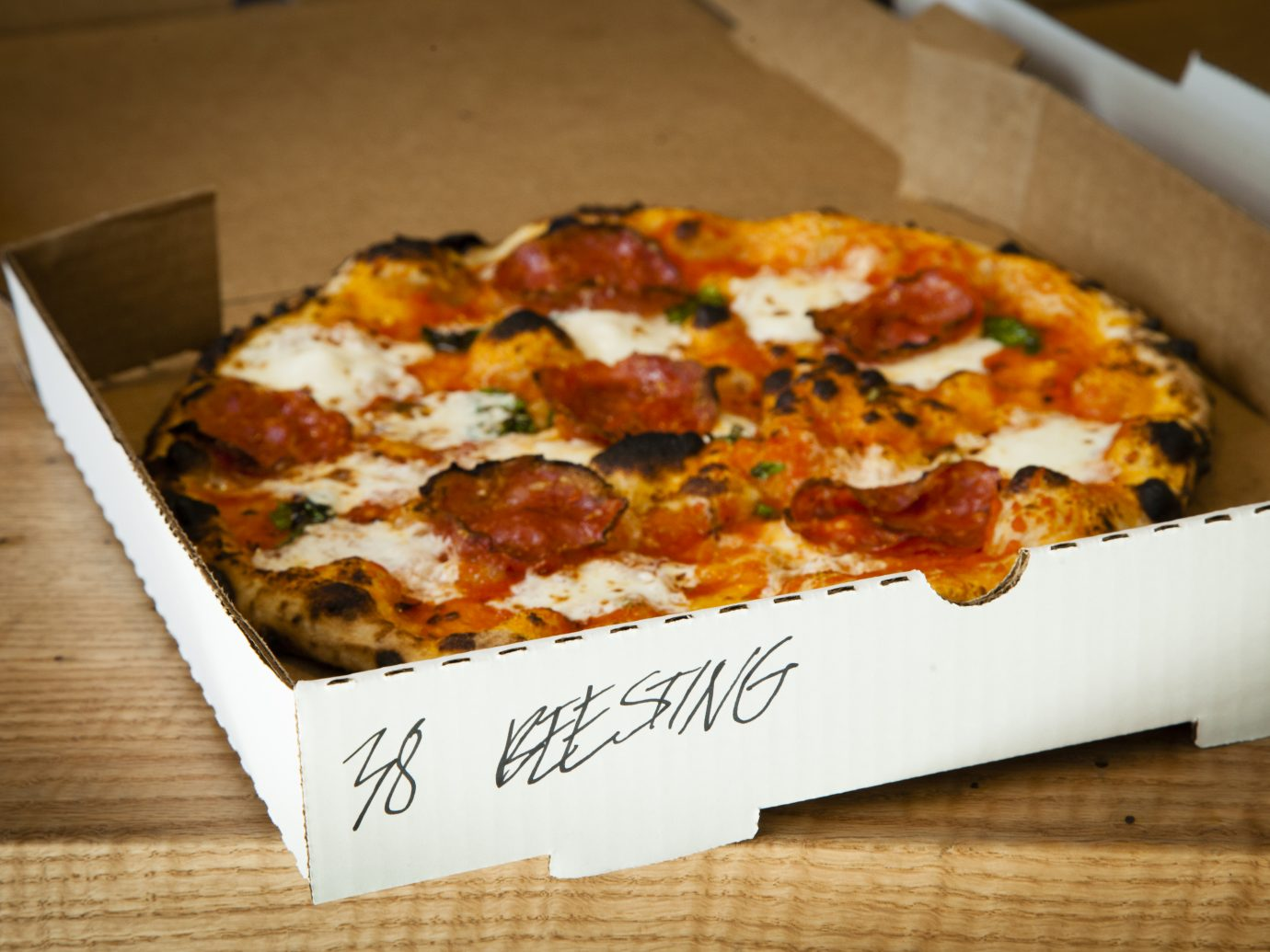 Roberta's Take-Out and Delivery Space, Brooklyn, NY; Beesting pizza in a to-go box. (Photograph by Deidre Schoo)