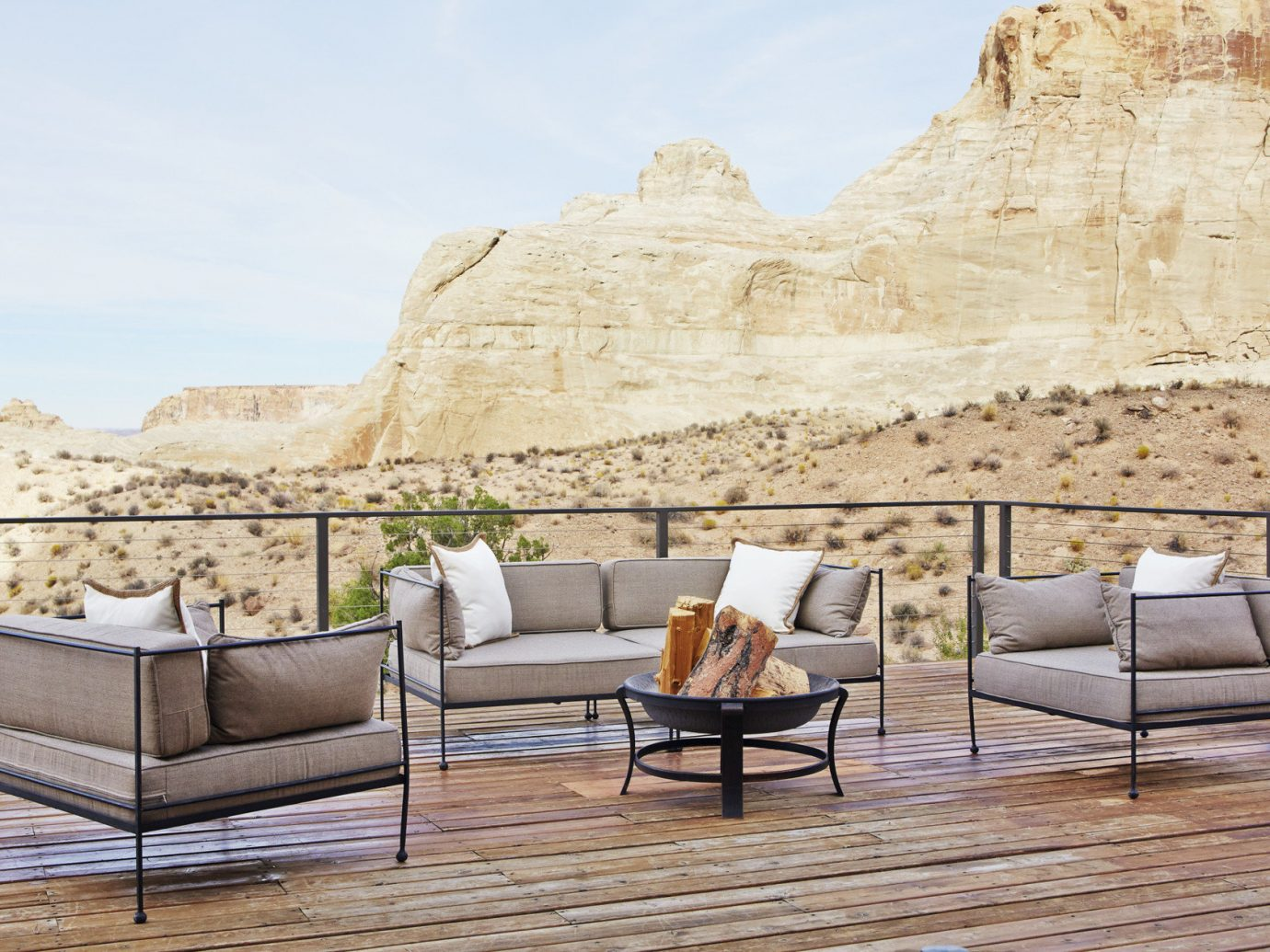 Lounge area on patio with view of desert scape