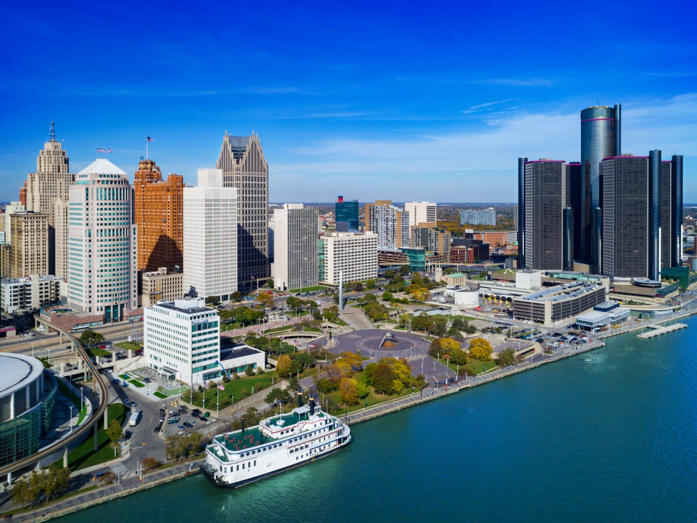 Downtown Detroit Aerial with Detroit River and a riverboat ferry in the foreground.